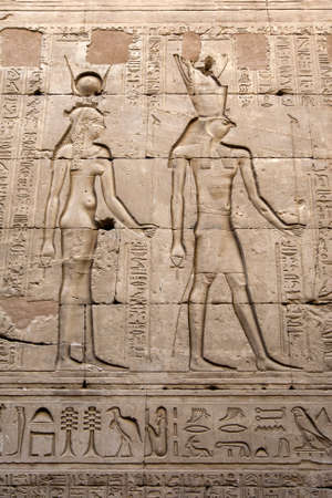 Engraved reliefs including one of falcon god Horus (right) and hieroglyphs on a wall inside the Temple of Horus at Edfu in central Egypt. Editorial