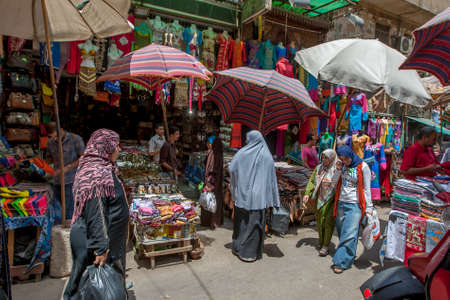 A busy section of the Khan el-Khalili Bazaar at Cairo in Egypt selling souvenirs, bags and clothing.