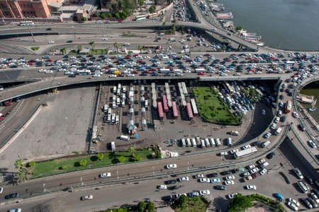 Peak hour traffic gridlock leading on and off the 6th October Bridge which crosses the River Nile at Cairo in Egypt.