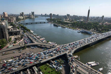Afternoon peak hour traffic gridlock over the 6th October Bridge which crosses the River Nile at Cairo in Egypt. Editorial