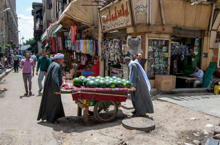 Men transport a cart loaded with watermelons through a street in the Khan el-Khalili Bazaar at Cairo in Egypt.