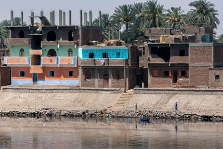 Houses line the bank of the River Nile at southern Edfu in central Egypt.