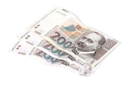 Three paper bills off 200 Croatian kunas isolated on white background