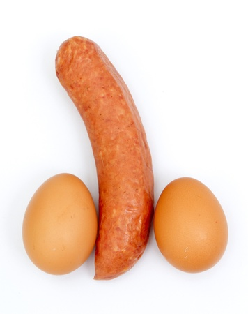 penis: Eggs and sausage ordered like penis and testicles isolated on white
