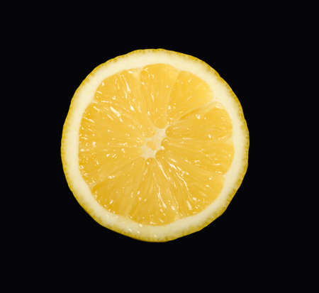Lemon intersected on half and isolated on black