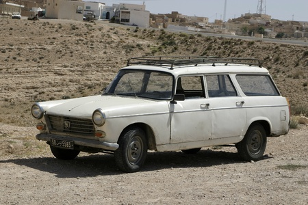 Chebika, Tunisia - July 22nd 2009: Old Peugeot 404 familiale 1968 model by the road.