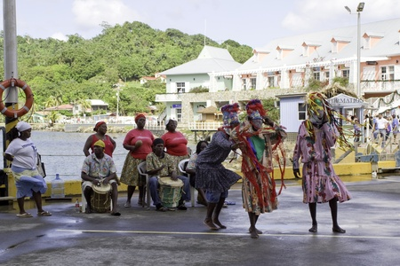 Coxen Hole, Roatan, Honduras - December 9th 2010: Traditional dancers in front of cruise ship wellcoming tourists. Editorial