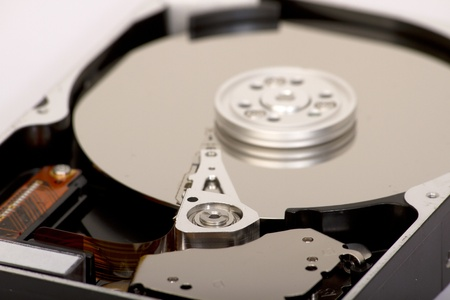 hard drive crash: Close up of open hard disk drive, cylinders and heads Stock Photo