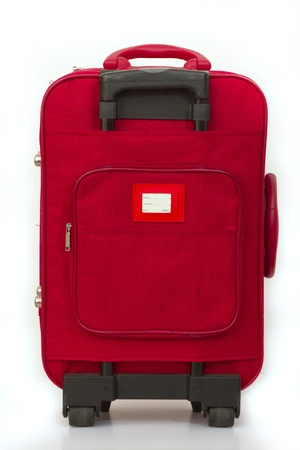 Red luggage isolated on white with tag Stock Photo