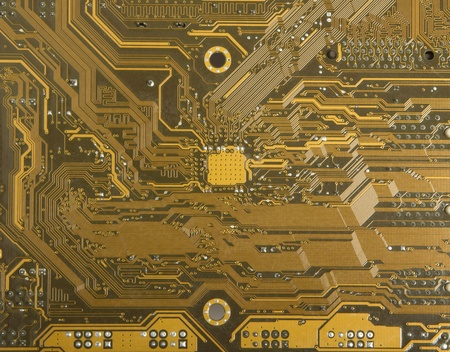 Electronic circuits on the back of the computer motherboard Stock Photo - 9457795