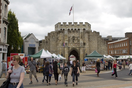 SOUTHAMPTON, UK - AUG 13: Crowd in pederstrian area of Southampton with historical Bargate in the bacground.