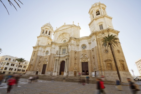 Wonderful cathedral of neoclassical style of ancient city of Cadiz, Spain. Blurred people,