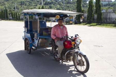 Tuk tuk taxy and driver in Sihanoukville, Cambodia Editorial
