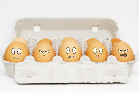 Happy, angry, scared and sad eggs in their box