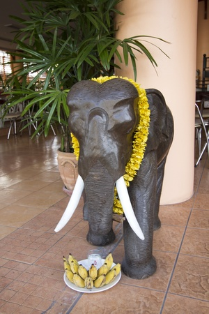 Figure of elephant with food offerings and flower necklace. Usual in Thailand as act of religion. Stock Photo - 12910728