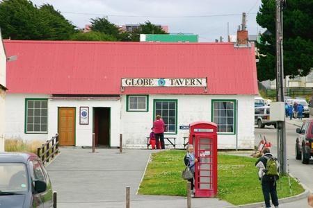 port stanley: GlobeTavern in Port Stanley, Falkland Islands. Tipically British pub. Red phone box in front.