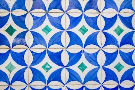 Old white tiles with blue painting Stock Photo