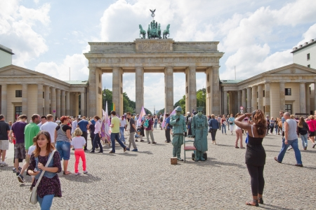 BERLIN, GERMANY, August 2012 - Tourists in front of Brandenburg Tor, Berlin. This is one of most famous landmarks in Belin.