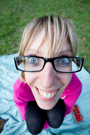 Wide angle shot from above of young woman with glasses