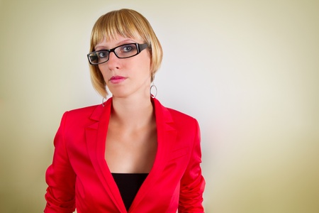 Portrait of young bussines woman in red suite with glasses  Lots of copyspace on right side  Stock Photo - 15496755