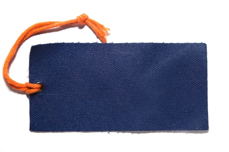 Denim cloth label with orange thread on white with visible shadow Stock Photo