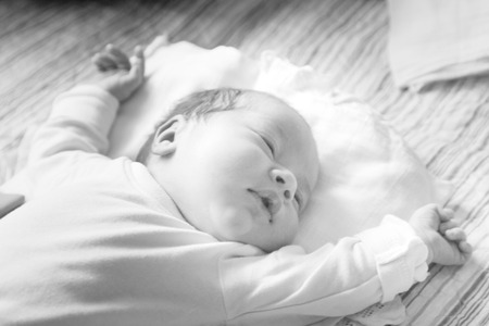 Beautiful small baby is sleeping. Black and white photo Stock Photo
