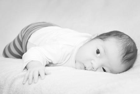 Small cute newborn baby black and white photo