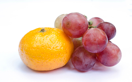 grape fruit: Red grape and orange isolated on white.