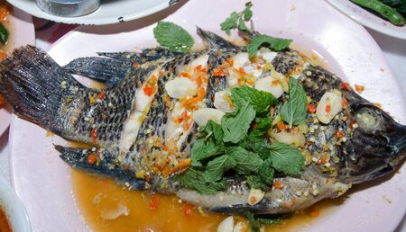 thai style: steamed Nilotica fish,thai style steamed fish in spicy sauce