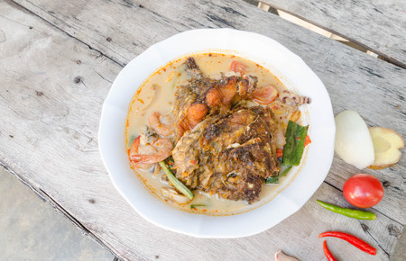 spicy food: Tom Yum Kung and fish -Thai spicy soup.
