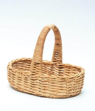 vintage weave wicker basket isolated on white  photo