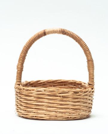 interleaved: vintage weave wicker basket isolated on white
