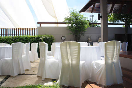 formal place setting: chair and table setting for fine dining at outdoors