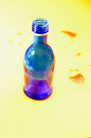 overly: Bottle blue background color. Stock Photo