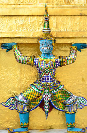 Statue at the Grand Palace ( Art in a temple in Thailand, there is no copyright notice) photo