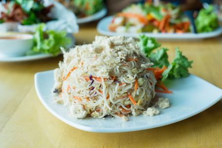 mee: Asian fried rice vermicelli with dried shredded pork topping.