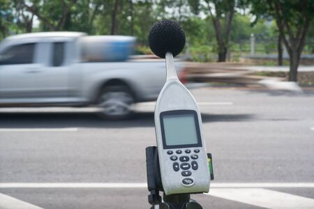 decibels: Measuring the noise of cars on the road with a sound level meter.