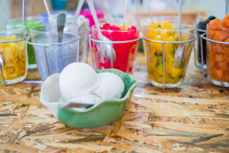 Thailand dessert with coconut ice cream, ice cream with toppings, selective focus Stock Photo