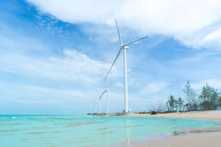 Wind turbine in the water park for onshore energy, Green energy, Selective energy. Stock Photo