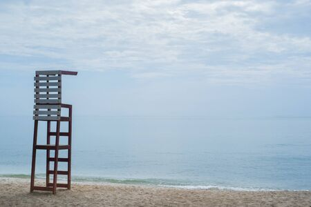 life guard: life guard chair on the beach with blue sky background Stock Photo