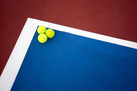 avocation: Old three tennis balls on tennis court.