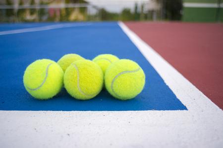 avocation: Old five tennis balls on tennis court. Stock Photo