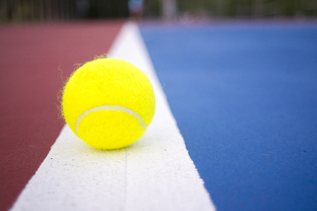 Tennis balls on tennis court. Stock Photo