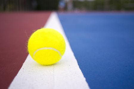 tennis ball on tennis court.