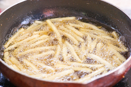 French Fries Boiling In Hot Oil