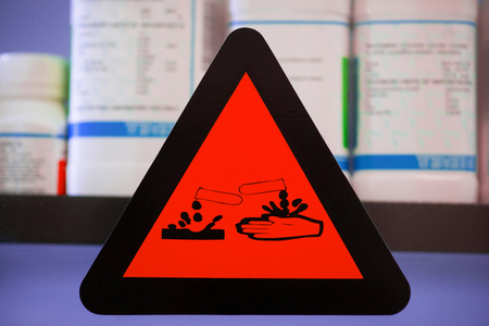 corrosive: Focus at label corrosive chemicals.Hazard symbol or warning sign