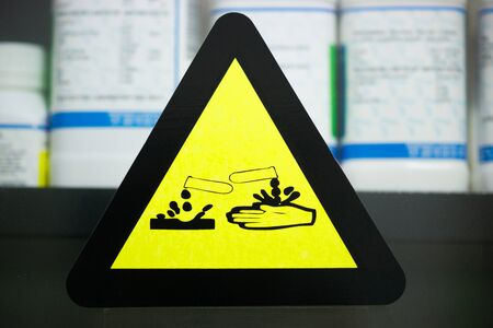 Focus at label corrosive chemicals.Hazard symbol or warning sign