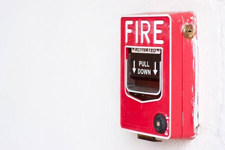 Fire alarm switch on factory wall Stock Photo