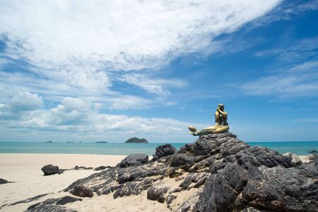 Seascape of sky and beach which has mermaid statue on rock ; Songkhla Thailand Stock Photo