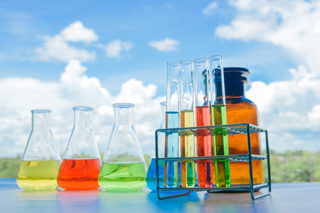 Laboratory glassware with colorful liquids for chemical experimental in laboratory, analysis research, science background Stock Photo